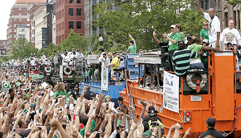 Ray Allen, upper right, salutes Boston fans during the Celtics parade on Thursday. The sharp-shooting guard helped the Big Green to the NBA championship in his first season with the team and 12th in the league.