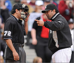 Despite his team's first-place standing, White Sox manager Ozzie Guillen made waves by publicly pressuring GM Ken Williams to make roster moves and criticized the media giving preferential treatment to the Cubs.