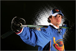 Zach Bogosian, the first American chosen in the NHL draft, poses for a photo in his Atlanta Thrashers jersey on Friday night. 19 Americans were selected in the first 100 picks.