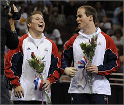 Gymnasts Jonathan Horton, left, and Paul Hamm celebrate after being named to the U.S. Olympic gymnastics team following the men's trials Saturday in Philadelphia. Hamm did not compete at the trials due to a hand injury.