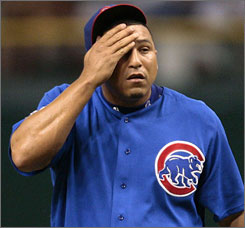Right-hander Carlos Zambrano wipes his brow during the third inning of the Cubs' 5-4 loss to Tampa Bay on June 18.