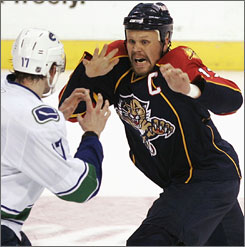 Former Panthers center Olli Jokinen fights during a game against the Canucks this past February. The Coyotes traded for Jokinen last weekend, hoping that the veteran can take some pressure off prized draft pick Kyle Turris.