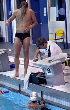 Genadijus Sokolovas, director of physiology for USA Swimming, tests swimmers for velocity and compares the results with footage from underwater cameras.