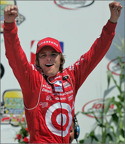 Dan Wheldon celebrates in Iowa Speedway's victory lane after his second IRL triumph of the season.
