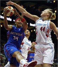 Detroit Shock's Tasha Humphrey, left, snares a rebound away from Atlanta's Katie Feenstra during the third period.