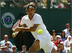 Roger Federer chases down a forehand during his first-round victory over Dominik Hrbaty. Federer is looking to capture his sixth straight crown at Wimbledon in 2008.