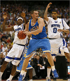 Kevin Love, center, guarded by Memphis' Robert Dozier, left, and Shawn Taggart during their Final Four showdown in April, backed up his claim of having a high basketball IQ with a good showing at the NBA's combine.