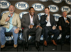 Michael Strahan, second from left, joins Terry Bradshaw, Howie Long and Jimmie Johnson when it was announced the former Giants defensive end would join Fox's pregame studio show.