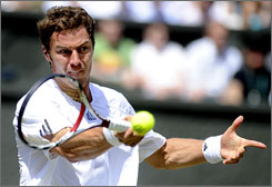 Marat Safin scored his biggest victory in years when he upended third-seeded Novak Djokovic in the second round at Wimbledon on Wednesday.