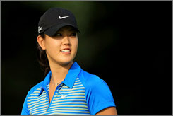 """Michelle Wie feels like she is """"re-emerging as a new player, a new person."""" The 18-year-old is looking to bounce back after a rocky 2007 in which she averaged 76.4 strokes per round."""