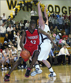 At 6-9, Shawn Kemp Jr. is almost the same height as his father, a former NBA All-Star.