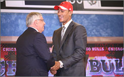 Derrick Rose shakes hands with NBA commissioner David Stern after going No. 1 to the Chicago Bulls.