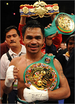 Manny Pacquiao poses with his new WBC lightweight title belt after knocking out David Diaz in the ninth round. Pacquiao's victory made him the first Asian boxer to win titles in four weight classes.