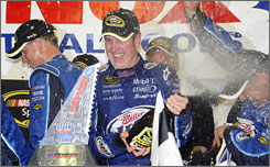 Kurt Busch and his crewmates celebrate their win of Sunday's NASCAR Sprint Cup race in Loudon, N.H.