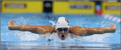 Ryan Lochte competes in the butterfly leg of the 400 IM during a preliminary heat of the Olympic swimming trials on Sunday. He finished ahead of Michael Phelps.