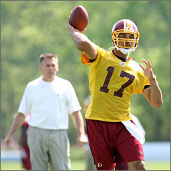 Redskins quarterback Jason Campbell will be working under his seventh different offense in the past eight years during the rookie year of head coach Jim Zorn, left.