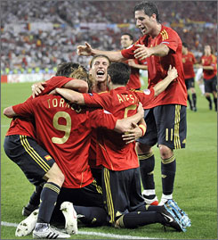 Spain's Fernando Torres (9) celebrates with teammates after scoring the only goal of the UEFA title game which gave Spain a 1-0 victory over Germany.