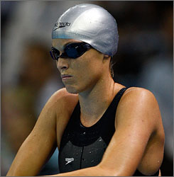Amanda Beard stretches before her semifinal heat of the 100-meter breaststroke during the U.S. Olympic swimming trials in Omaha. Beard is no stranger to the Olympics  she competed 12 years ago in Atlanta  and is hoping to make it to Beijing after taking a two-year break from the sport.