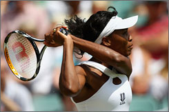 Venus Williams hits a shot during her fourth-round victory on Court 2 at the All England Club. After the match, Williams and others in the women's draw thought they were disrespected with the schedule on Monday.