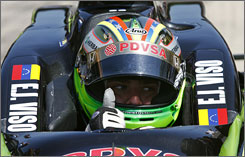 Driver E.J. Viso sits in his car during practice at the Indianapolis Motor Speedway on May 4. The 23-year-old is now 12th in the IndyCar points standings.