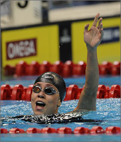 Natalie Coughlin excelled in the backstoke and became the first woman to break 59 seconds. She posted a time of 58.97.