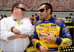 Dario Franchitti talks with team owner Chip Ganassi in happier times. Franchitti was in his first NASCAR season driving Ganassi's No. 40 car, ranking 41st in the points standings after Sunday's race at Loudon, N.H.