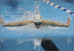 """Katie Hoff set new American records in the 200 freestyle and 200 individual medley. """"I'm in great shape,"""" Hoff said after pulling off swimming's version of the daily double. """"I've trained to swim a lot of events in one night. I'm glad my training pulled through."""""""