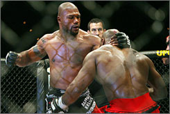 """Quinton """"Rampage"""" Jackson (left, battling Marvin """"The Beastman"""" Eastman in 2007) and opponent Forrest Griffin were rival coaches in The Ultimate Fighter. They meet on Saturday."""