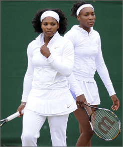 Serena and Venus Williams, here preparing for a doubles match on Wednesday, will each play semifinal simgles matches on Thursday to try and set up family matchup in Saturday's championship.