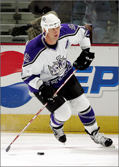 Seven-time All-Star defenseman Rob Blake, who spent 13 of his 18 NHL seasons with the Kings, signed with the  Sharks  for an immediate shot at winning a Stanley Cup championship.