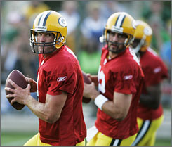 Will Brett Favre return to the Packers for training camp to work alongside his understudy, Aaron Rodgers (center), again?
