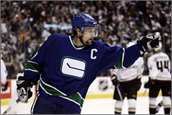 Markus Naslund spent 12 seasons in Vancouver, including the last eight seasons as the Canucks' captain,  before signing a two-year contract with the Rangers.