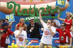 Joey Chestnut, right, needed overtime to beat Takeru Kobayashi in the annual hot dog eating contest.