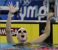Lara Jackson checks the scoreboard, reflecting her American record in the 50-meter freestyle.