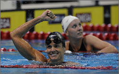 Dara Torres celebrates after setting an American record in the women's 50-meter freestyle at the U.S. Olympic swimming trials.