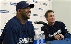 New Milwaukee pitcher CC Sabathia, left, smiles with manager Ned Yost as he talks at a news conference Monday after the Brewers obtained the reigning AL Cy Young Award winner in a trade with the Cleveland Indians.