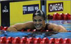 Dara Torres smiles after winning the women's 100-meter freestyle final at the Olympic swimming trials in Omaha. The 41-year-old mother earned a fifth trip to the Olympics with her performance.