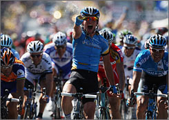 Mark Cavendish celebrates as he crosses the line to win Stage 5 from Cholet to Chateauroux.