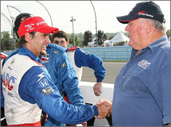 A.J. Foyt congratulates Darren Manning on his career-best finish in the Indy Racing League.