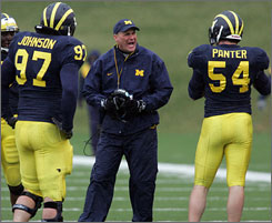 Rich Rodriguez parted with West Virginia last December and now is coaching Michigan.
