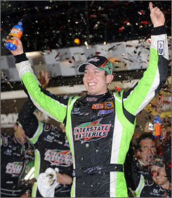 Kyle Busch celebrates winning the Coke Zero 400 at Daytona International Speedway on July 5. The Sprint Cup points leader has never finished higher than third at Chicagoland, but Busch will have his chance to better that on Saturday.