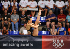 Haley Ishimatsu competes at the Olympic trials for diving in June. The 15-year-old was named to the Olympic team in July. She and her father moved to Indianapolis in 2006 to focus on her dream of diving in the Olympics.