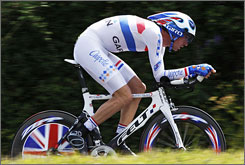 David Millar competes in the time trial on July 8. The British rider on the Garmin-Chipotle team is one of many riders dealing with the Tour de France's lack of time bonuses.