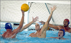 Tony Azevedo, center white cap, will head the men's water polo team.