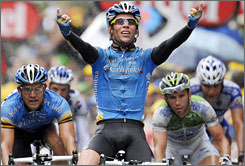 Team Columbia's Mark Cavendish, of Great Britain, celebrates his win in Stage 8 of the Tour de France on Saturday.