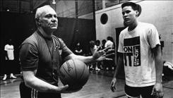 William Tennent high School boys basketball coach Cecil Mosenson explains a play while Adam Zubik looks on in 1991.