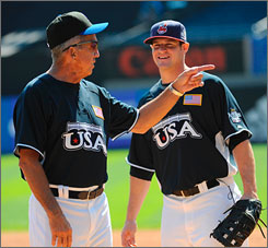 Team USA manager Davey Johnson gives a few pointers to first baseman Matt LaPorta before the All-Star Futures game at Yankee Stadium. Johnson will also manage the American squad in Beijing at the Summer Olympics.