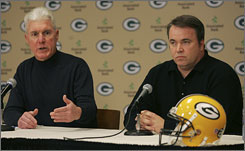 """Favre's welcome back,"" Packers general manager Ted Thompson, left, says, ""but the scenery has changed. There may be a different role."""