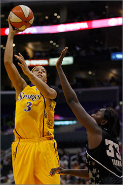 Los Angeles Sparks' Candace Parker shoots over Sophia Young of the San Antonio Silver Stars. Parker's 24 points and 10 rebounds paced the Sparks to a 75-62 win.