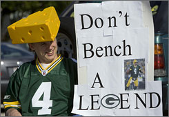 A Packers fan shows his support for Brett Favre at a rally on Monday.